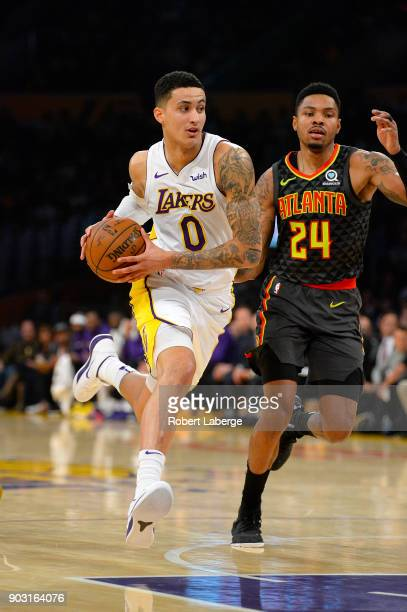 Kyle Kuzma of the Los Angeles Lakers plays against Kent Bazemore of the Atlanta Hawks on January 7 2018 at STAPLES Center in Los Angeles California...