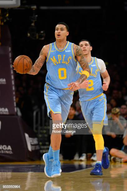 Kyle Kuzma of the Los Angeles Lakers plays against the Orlando Magic as Lonzo Ball of the Lakers looks on on March 7 2018 at STAPLES Center in Los...