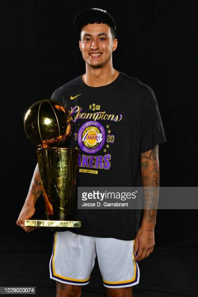 Kyle Kuzma of the Los Angeles Lakers poses for a photo with the Larry O'Brien Trophy after winning Game Six of the NBA Finals against the Miami Heat...