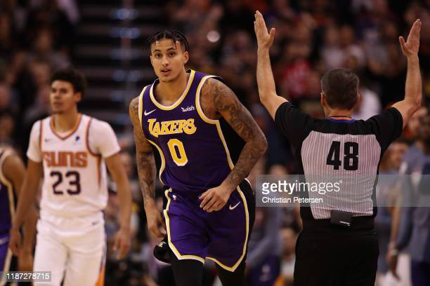 Kyle Kuzma of the Los Angeles Lakers reacts after hitting a three point shot over Cameron Johnson of the Phoenix Suns during the second half of the...
