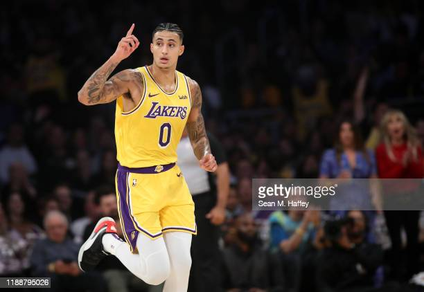 Kyle Kuzma of the Los Angeles Lakers reacts after making a three point shot during the first half of a game against the Oklahoma City Thunder at...