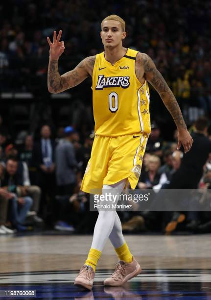Kyle Kuzma of the Los Angeles Lakers reacts after making a threepoint shot against the Dallas Mavericks at American Airlines Center on January 10...