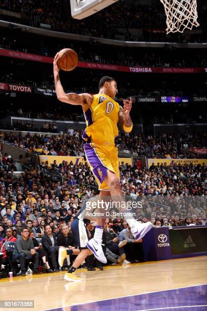 Kyle Kuzma of the Los Angeles Lakers rebounds the ball during the game against the Denver Nuggets on March 13 2018 at STAPLES Center in Los Angeles...