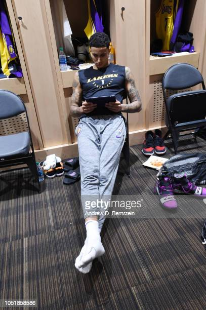 Kyle Kuzma of the Los Angeles Lakers reviews material before a preseason game against the Golden State Warriors on October 10 2018 at TMobile Arena...