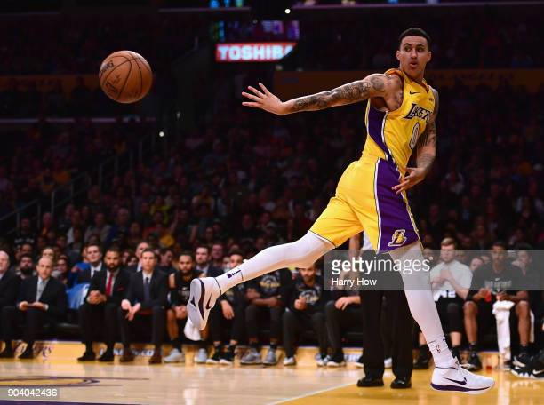 Kyle Kuzma of the Los Angeles Lakers saves a ball from going out of bounds during a 9381 win over the San Antonio Spurs at Staples Center on January...