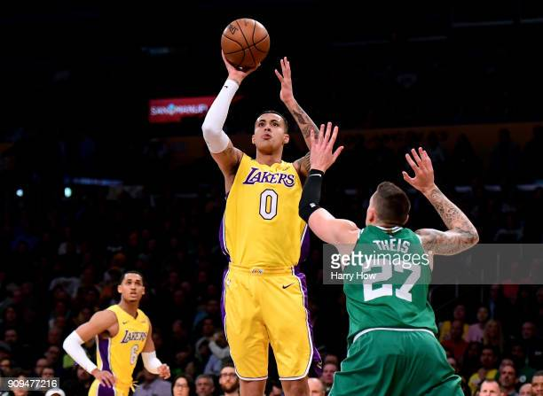 Kyle Kuzma of the Los Angeles Lakers scores on a jumper over Daniel Theis of the Boston Celtics during the first half at Staples Center on January 23...