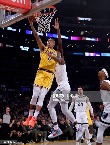 Kyle Kuzma of the Los Angeles Lakers scores past Jaren Jackson Jr #13 of the Memphis Grizzlies during the first quarter at Staples Center on February...