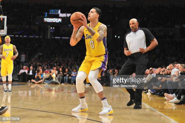 Kyle Kuzma of the Los Angeles Lakers shoots a three pointer during the fourth quarter of a basketball game against the Portland Trail Blazers at...