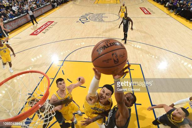 Kyle Kuzma of the Los Angeles Lakers shoots contested shot against the Golden State Warriors on February 2 2019 at the Pepsi Center in Denver...