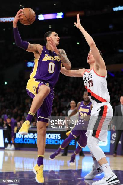 Kyle Kuzma of the Los Angeles Lakers shoots over Zach Collins of the Portland Trail Blazers during the first half of a game at Staples Center on...
