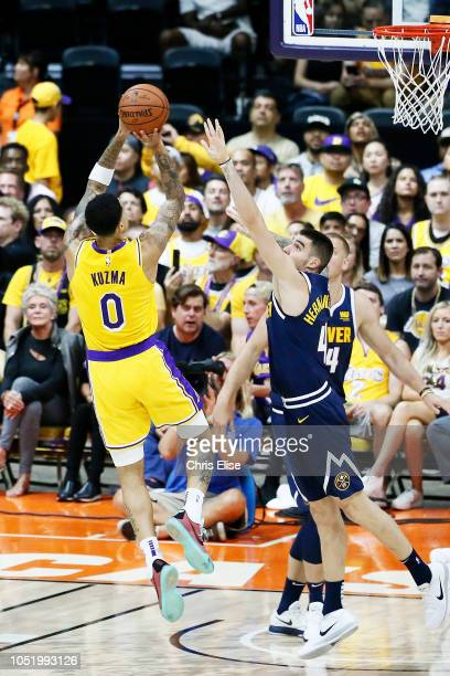Kyle Kuzma of the Los Angeles Lakers shoots the ball against the Denver Nuggets on September 30 2018 at Valley View Casino Center in San Diego...