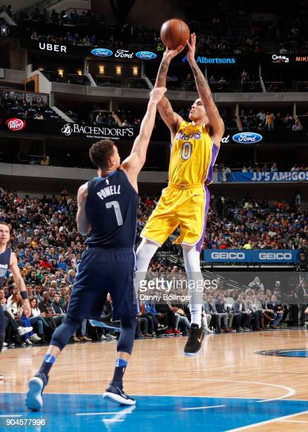 Kyle Kuzma of the Los Angeles Lakers shoots the ball against the Dallas Mavericks on January 13 2018 at the American Airlines Center in Dallas Texas...