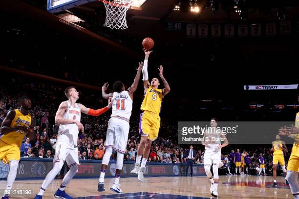 Kyle Kuzma of the Los Angeles Lakers shoots the ball in overtime against the New York Knicks on December 12 2017 at Madison Square Garden in New York...