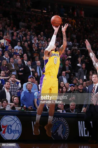 Kyle Kuzma of the Los Angeles Lakers shoots the ball to tie the game with 23 seconds left against the New York Knicks on December 12 2017 at Madison...