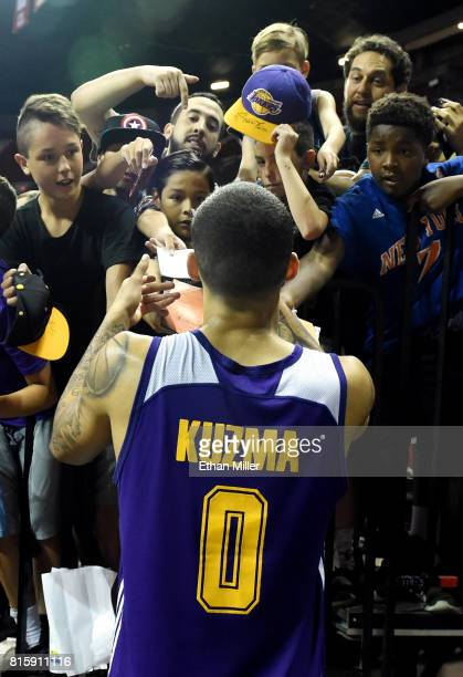 Kyle Kuzma of the Los Angeles Lakers signs autographs for fans after the team's 10898 win over the Dallas Mavericks in a semifinal game of the 2017...