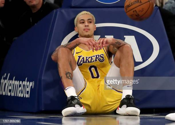 Kyle Kuzma of the Los Angeles Lakers sits on the court after he was fouled in the second half against the New York Knicks at Madison Square Garden on...