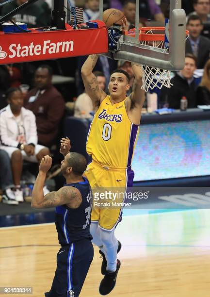 Kyle Kuzma of the Los Angeles Lakers takes a shot against Devin Harris of the Dallas Mavericks at American Airlines Center on January 13 2018 in...