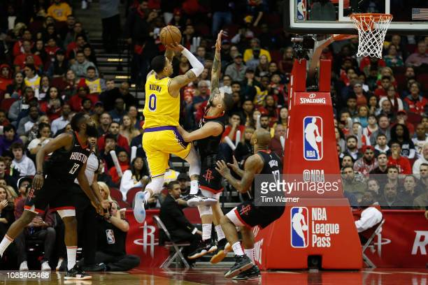 Kyle Kuzma of the Los Angeles Lakers takes a shot defended by Austin Rivers of the Houston Rockets in the first half at Toyota Center on January 19...