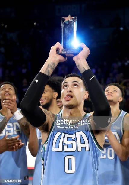 Kyle Kuzma of the US Team holds the MVP trophy after the 2019 Mtn Dew ICE Rising Stars at Spectrum Center on February 15 2019 in Charlotte North...