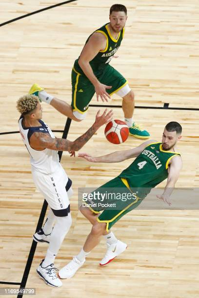 Kyle Kuzma of the USA and Chris Goulding of the Boomers contest the ball during the International Basketball Friendly match between the Australian...