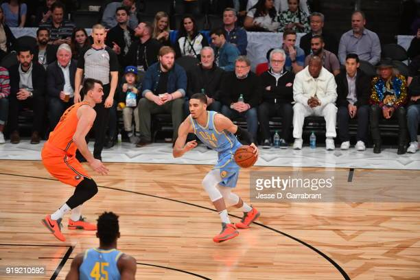 Kyle Kuzma of the USA Team dribbles the ball against the World Team during the Mountain Dew Kickstart Rising Stars Game during AllStar Friday Night...