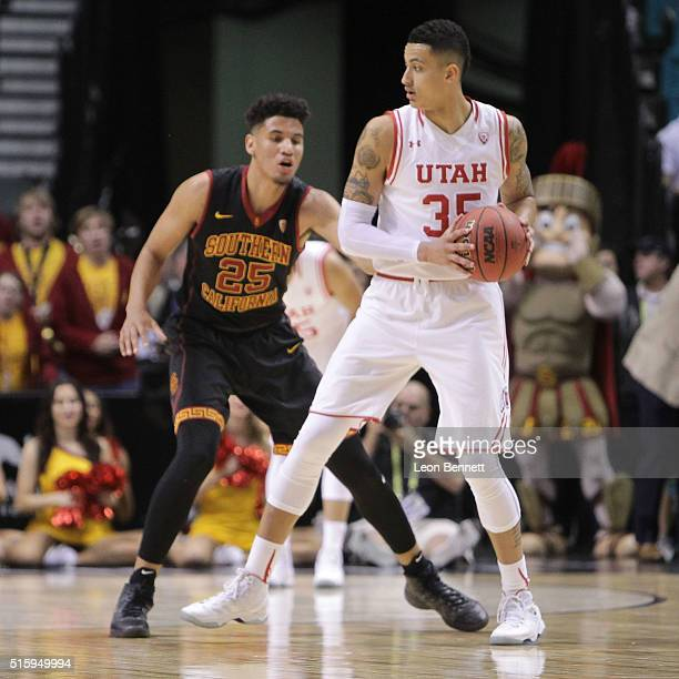 Kyle Kuzma of the Utah Utes handles the ball against Bennie Boatwright of the USC Trojans during a quarterfinal game of the Pac12 Basketball...