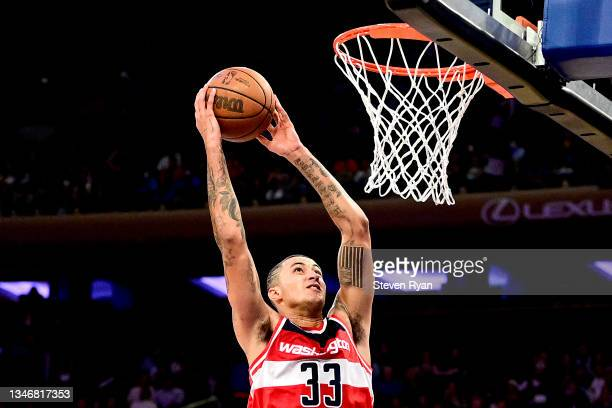 Kyle Kuzma of the Washington Wizards dunks the ball against the New York Knicks during a preseason game at Madison Square Garden on October 15, 2021...