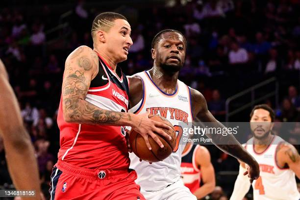 Kyle Kuzma of the Washington Wizards is defended by Julius Randle of the New York Knicks during a preseason game at Madison Square Garden on October...