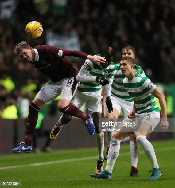 Kyle Lafferty of Heart of Midlothian wins a header during the Scottish Premier League match between Celtic and Heart of Midlothian at Celtic Park on...