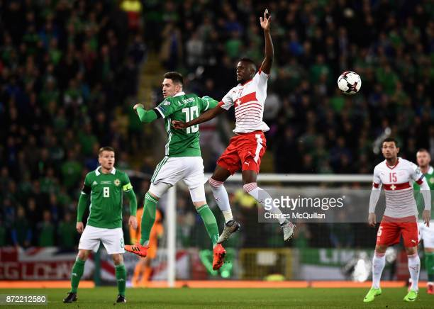 Kyle Lafferty of Northern Ireland and Danis Zakaria of Switzerland in action during the FIFA 2018 World Cup Qualifier PlayOff First Leg between...