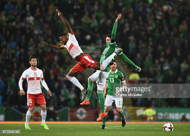 Kyle Lafferty of Northern Ireland and Denis Zakaria of Switzerland during the FIFA 2018 World Cup Qualifier PlayOff first leg between Northern...