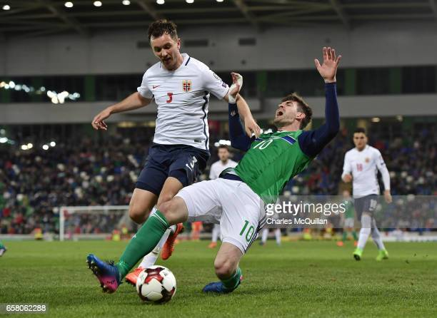 Kyle Lafferty of Northern Ireland and Even Hovland of Norway during the FIFA 2018 World Cup Qualifier between Northern Ireland and Norway at Windsor...