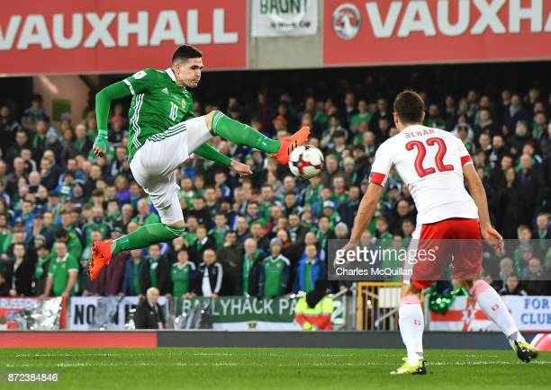 Kyle Lafferty of Northern Ireland and Fabian Schar of Switzerland during the FIFA 2018 World Cup Qualifier PlayOff first leg between Northern Ireland...