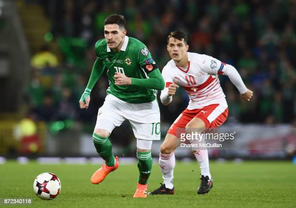 Kyle Lafferty of Northern Ireland and Granit Xhaka of Switzerland during the FIFA 2018 World Cup Qualifier PlayOff first leg between Northern Ireland...