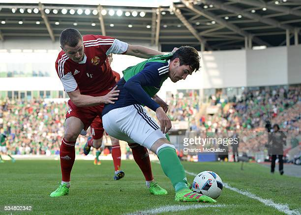 Kyle Lafferty of Northern Ireland and Ihar Shytau of Belarus during the international friendly game between Northern Ireland and Belarus on May 26...