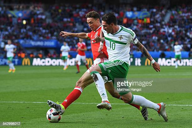 Kyle Lafferty of Northern Ireland and James Chester of Wales compete for the ball during the UEFA EURO 2016 round of 16 match between Wales and...