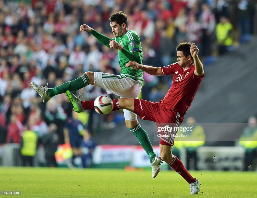 Kyle Lafferty (L) of Northern Ireland and Richard Guzmics (R) of Hungary during the Euro 2016 Group F qualifying match at Windsor Park on September 7, 2015 in Belfast, Northern Ireland.