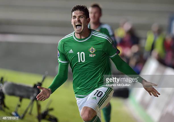 Kyle Lafferty of Northern Ireland celebrates after scoring a late equaliser during the Euro 2016 Group F qualifying match between Northern Ireland...