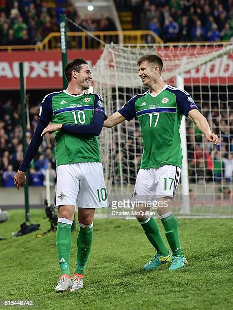 Kyle Lafferty of Northern Ireland celebrates after scoring with team mate Paddy McNair during the FIFA 2018 World Cup Qualifier between Northern...