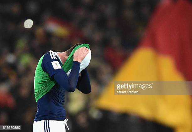 Kyle Lafferty of Northern Ireland looks dejected following defeat during the FIFA 2018 World Cup Qualifier between Germany and Northern Ireland at...