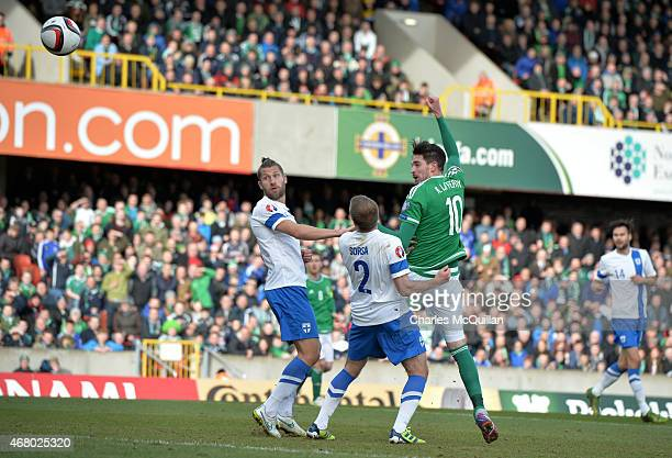 Kyle Lafferty of Northern Ireland scores with a header to make the score 20 during the EURO 2016 Group F qualifier at Windsor Park on March 29 2015...