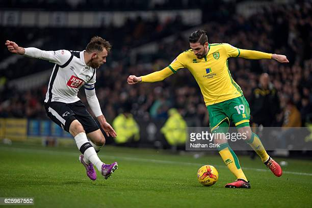 Kyle Lafferty of Norwich City and Richard Keogh of Derby County in action during the Sky Bet Championship match between Derby County and Norwich City...