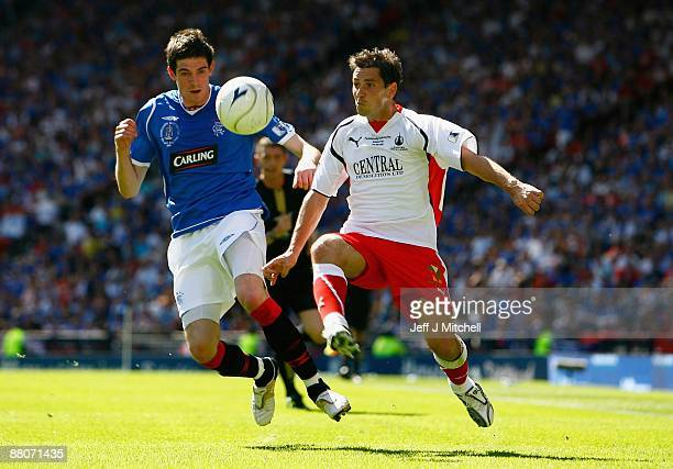 Kyle Lafferty of Rangers challenges Jackie McNamara of Falkirk during the Scottish FA Cup Final match between Rangers and Falkirk at Hampden Park on...