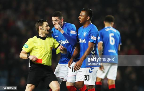 Kyle Lafferty of Rangers remonstrates with referee Steven McLean after Alfredo Morelos of Rangers lis given a second yellow card during the Scottish...