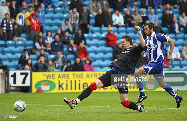 Kyle Lafferty of Rangers scores during the Clydesdale Bank Premier League match between Kilmarnock and Rangers at Rugby Park on May 15 2011 in...