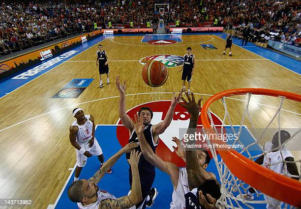 Kyle Landry of Triumph jumps for a rebound as Hristo Nikolov and his team mate Marton Bader of Szolnoki during the FIBA Europe EuroChallenge Final...