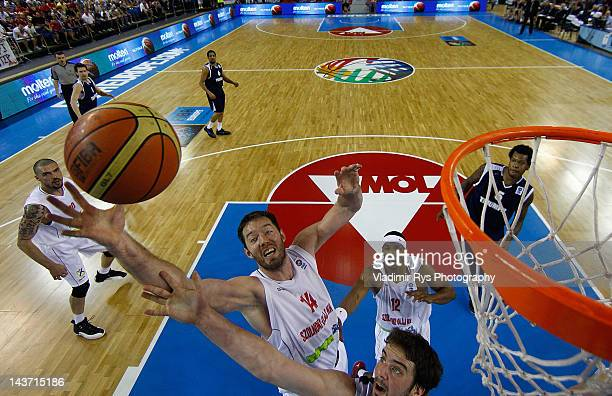 Kyle Landry of Triumph jumps for a rebound as Marton Bader of Szolnoki defends during the FIBA Europe EuroChallenge Final Four third place game...