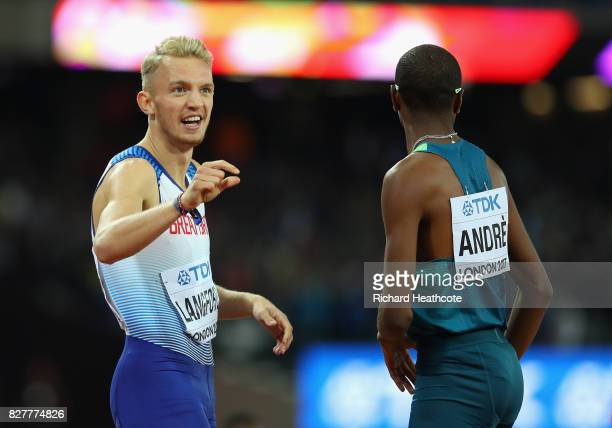Kyle Langford of Great Britain and Thiago Andre of Brazil react after the Men's 800 metres final during day five of the 16th IAAF World Athletics...