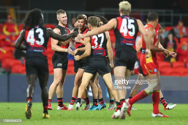 Kyle Langford of the Bombers celebrates a goal during the round 11 AFL match between the Gold Coast Suns and the Essendon Bombers at Metricon Stadium...
