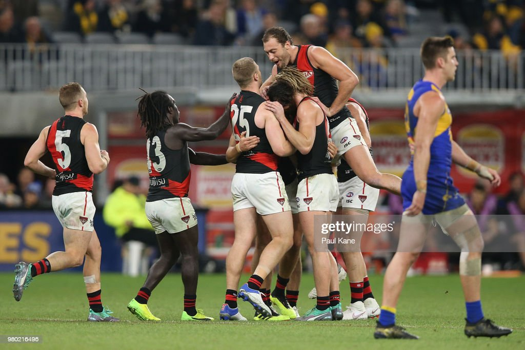 Kyle Langford of the Bombers is congratulated after kicking a goal during the round 14 AFL match between the West Coast Eagles and the Essendon Bombers at Optus Stadium on June 21, 2018 in Perth, Australia.